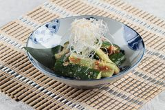Sunomono Japanese cucumber salad including cut cucumber mixing with rice vinegar, sugar , salt and white sesame. Stock Photos
