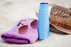 Sunprotection objects on the beach in holiday. Sunglasses hat suncare Stock Photo