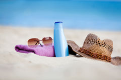 Sunprotection objects on the beach in holiday. Sunglasses hat suncare Stock Images