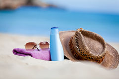 Sunprotection objects on the beach in holiday. Sunglasses hat suncare Royalty Free Stock Images