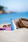 Sunprotection objects on the beach in holiday. Sunglasses hat suncare Royalty Free Stock Photos