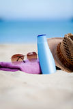 Sunprotection objects on the beach in holiday. Sunglasses hat suncare Royalty Free Stock Photo