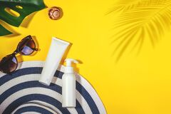 Free Sunprotection Objects. Hat With Sunglasses, Protection Cream SPF On Yellow Background. Beach Accessories. Summer Concept Royalty Free Stock Images - 174264419