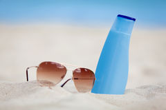 Sunprotection summer holiday sunglasses and cream Stock Photography