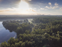 Sunraise morning summer time lake and green forest, in Poland la Stock Photos