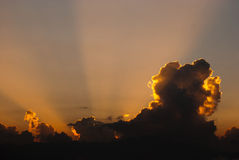 Sunray through cloud Stock Photo