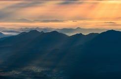 Sunray mountain beautiful. Landscape Sunset sunray Yellow Gold on mountain beautiful clouds royalty free stock photo