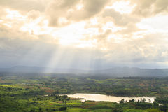 Sunray over lake and mountain in Khao Kho District, Thailand Royalty Free Stock Images