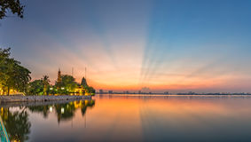 Sunray side West Lake, Hanoi, Vietnam. With pink ray rays sky illuminated side Tran Quoc pagoda makes the sunset as a theatrical dance in the sky stock images