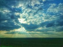 Sunrays break trough clouds HDR Stock Photography