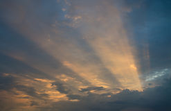 Sunrays through clouds. Clear sunrays through a layer of clouds Stock Image