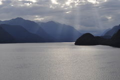 Sunrays through the clouds Milford Sound New Zealand Stock Images