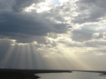 Sunrays, Clouds & River with Silver Lining Stock Image