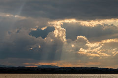 Sunrays and clouds Stock Images