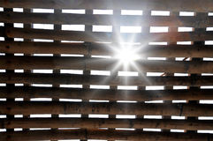 Sunrays coming through bamboo cage, jail in Vietnam Royalty Free Stock Image