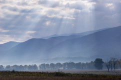 Sunrays cover the open fields of Cades Cove. Stock Photos