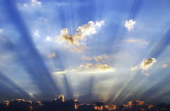 Sunrays Emerging From The Cloud Stock Photos