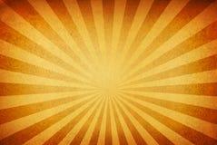 Sunrays gegen einen grungy Hintergrund Stockfotografie