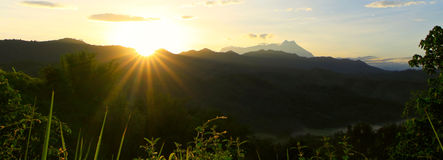 Sunrays and hills at Sabah, Borneo Royalty Free Stock Photography