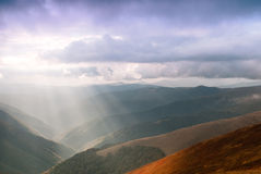 Sunrays in mountains Stock Images