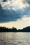 Sunrays over a jungle river Royalty Free Stock Image