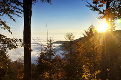 Sunrays over Medvednica mountain. Autumn Sun producing strong rays while setting above the sea of clouds in the lowlands under Medvednica mountan in Croatia Royalty Free Stock Photos