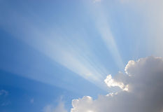 Sunrays passing through clouds Royalty Free Stock Image