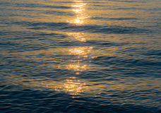 Sunrays and sea. Sunrays in the sea water stock images