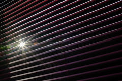 Sunrays through the Venetian blinds Stock Photography