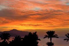 Sunrice and beach with a view on Tiran island Royalty Free Stock Photos