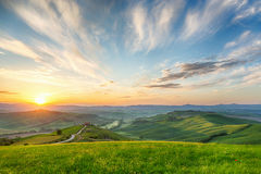 Sunrice in a rolling hill landscape Stock Image