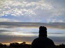 Sunrise 1. Figure watching sunrise Stock Images