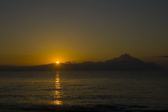 Sunrise. And the mountain Athos Stock Images