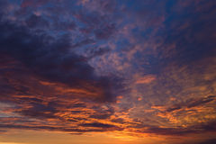 Sunrise. A beautiful breaking sunrise background with orange and blue clouds Stock Photo