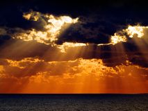 Sunrise. Sunrise over sea with dark dramatic clouds Royalty Free Stock Photography