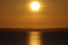 Sunrise. At sea on a winter day Royalty Free Stock Photography
