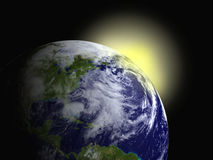 Sunrise. Computer generated earth with morning sunrise on behind Stock Images