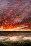 Sunrise. Dramatic landscape of sunrise scenery with red clouds in sky in countryside in Taiwan, Asia Stock Photography