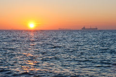 Sunrise. Sunrise in the sea. Ships on the background Royalty Free Stock Photos