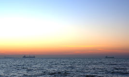 Sunrise. Sunrise in the sea. Ships on the background Royalty Free Stock Image
