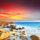 Sunrise. Over the sea. Stone on the foreground Royalty Free Stock Photo