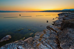 Sunrise. Lake Geneva sunrise from a man made beach Stock Images