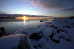 Sunrise. In the winter at the sea Stock Image
