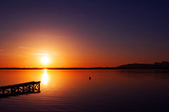 Sunrise. Red sunrise over the Chiemsee lake near Munich, Bayern, Germany Royalty Free Stock Images