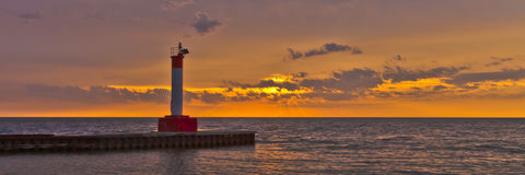 Sunrise. A view of a beautiful sunrise over Lake Ontario at the Oakville lighthouse pier Stock Images