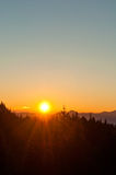 Sunrise. Through trees on Mount Ceahlau Royalty Free Stock Photography