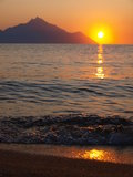Sunrise. Sun is rising from behind athos mountain Stock Photo