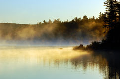 Sunrise. And mist in beautiful lake in Algonquin Park Royalty Free Stock Image
