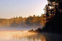 Sunrise. And mist in beautiful lake in Algonquin Park Royalty Free Stock Photo