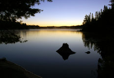 Sunrise. And mist in beautiful lake in Algonquin Park Stock Photo